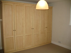 molding(0.0), door(0.0), floor(1.0), furniture(1.0), wood(1.0), room(1.0), cupboard(1.0), wardrobe(1.0), hardwood(1.0), cabinetry(1.0),