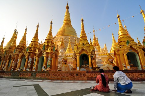 Praying couple at Shwedagon Pagoda in Yangon, Myanmar