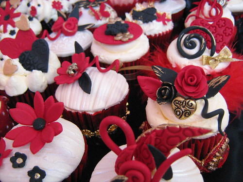 red , black and gold wedding cupcakes