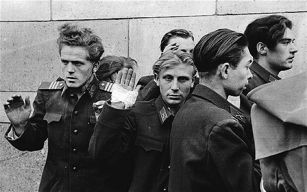 Just prior to the execution by Hungarian Freedom Fighters of young officers of the Secret Police are led up against a wall, Budapest 1956, by John Sadovy