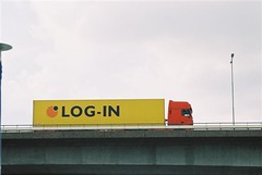 Log-in truck on bridge