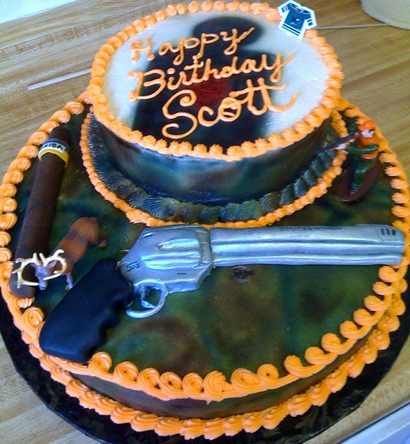 camo cake with gun and cigar