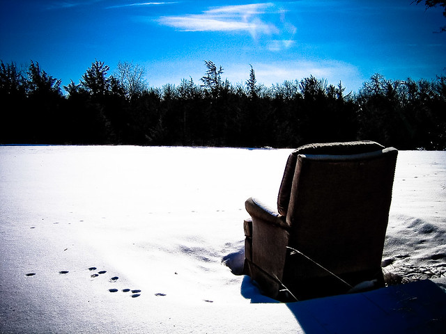Abandoned chair in a snowfield in rural Washington County, Minnesota.