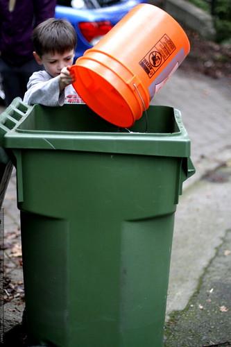 nick depositing a bucket of leaves