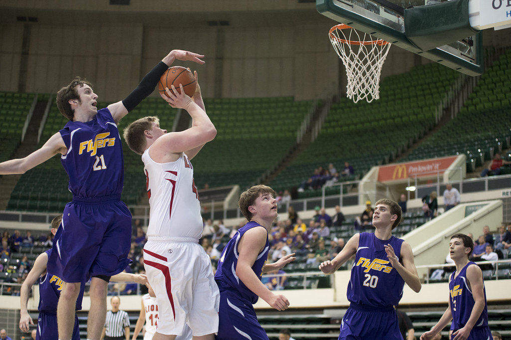St. Joes forward Troy Scott attempts to block a shot down low by Fairfield's Joey Wilson.