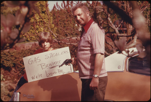 Country's Fuel Shortage Led to Problems for Motorists in Finding Gas as Well as Paying Much More for It, and Resulted in Theft From Cars Left Unprotected. This Father and Son, Made a Sign Warning Thieves of the Possible Consequences 04/1974