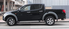 mazda bt-50(0.0), compact sport utility vehicle(0.0), automobile(1.0), automotive exterior(1.0), pickup truck(1.0), vehicle(1.0), truck(1.0), bumper(1.0), nissan navara(1.0), mitsubishi triton(1.0), land vehicle(1.0),