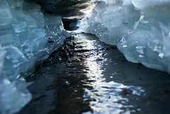formation(0.0), stream(1.0), ice cave(1.0), water(1.0), melting(1.0), ice(1.0), reflection(1.0), freezing(1.0),
