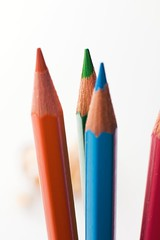 crayon(0.0), pink(0.0), orange(1.0), red(1.0), pencil(1.0), office supplies(1.0),