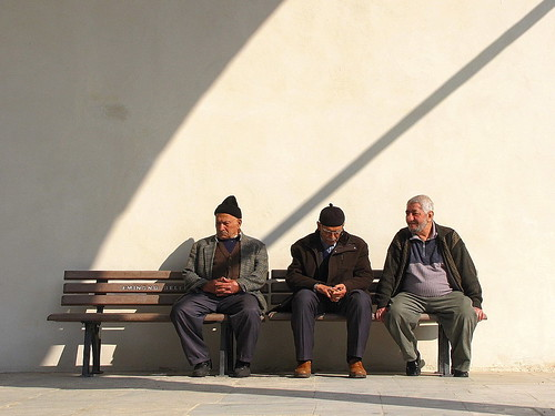 three men outside a mosque