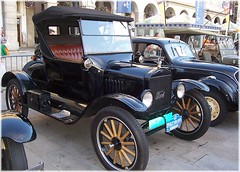 sedan(0.0), automobile(1.0), ford model a(1.0), wheel(1.0), vehicle(1.0), touring car(1.0), ford(1.0), antique car(1.0), classic car(1.0), vintage car(1.0), land vehicle(1.0), luxury vehicle(1.0), ford model t(1.0), motor vehicle(1.0),