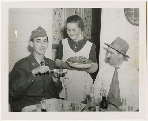 Pfc. Morton Gutstadt tried out the gefilte fish of Mrs. Dave Starr…, 1952