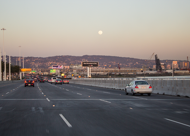 daytime moon over the freeway