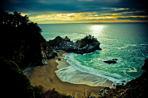 julia pfeiffer burns state park waterfall on beach at sunset