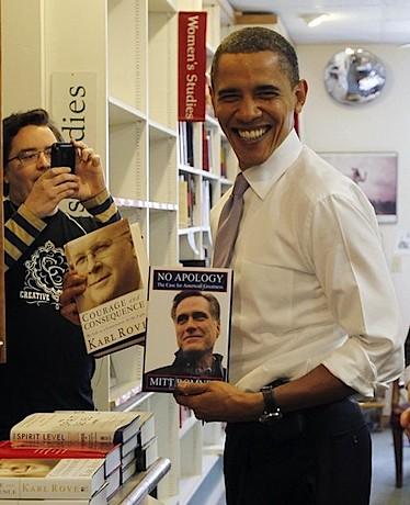 Barack Obama holding Mitt Romney's book