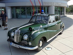 austin fx4(0.0), mid-size car(0.0), mitsuoka viewt(0.0), compact car(0.0), sedan(0.0), automobile(1.0), vehicle(1.0), bmw 501(1.0), antique car(1.0), classic car(1.0), vintage car(1.0), land vehicle(1.0), luxury vehicle(1.0),