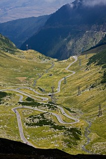 Road with hairpin turns through mountain valley