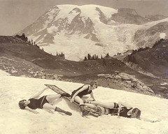 Staged toboggan accident involving three women in bathing suits, Mount Rainier National Park