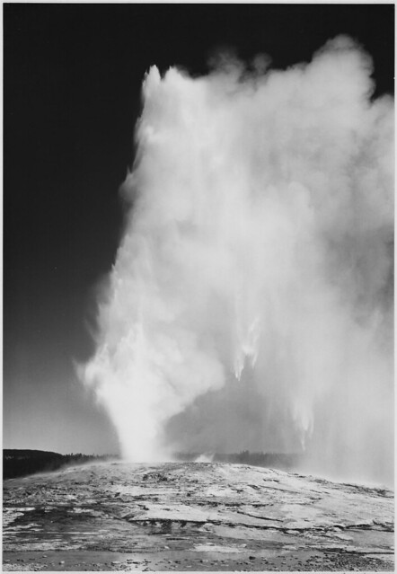 """Taken at dusk or dawn from various angles during eruption. """"Old Faithful Geyser, Yellowstone National Park,"""" Wyoming. (vertical orientation)"""