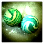 Two bouncy balls like twin planets of earth and water