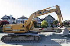 asphalt(0.0), demolition(0.0), crane(0.0), vehicle(1.0), construction equipment(1.0), bulldozer(1.0), land vehicle(1.0),