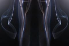 radiography(0.0), medical radiography(0.0), arm(0.0), chest(0.0), x-ray(0.0), human body(0.0), screenshot(0.0), darkness(0.0), flame(0.0), organ(0.0), smoke(1.0), light(1.0), close-up(1.0),