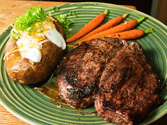 Sirloin Steak, Baked Potato, and Sauteed Carrots