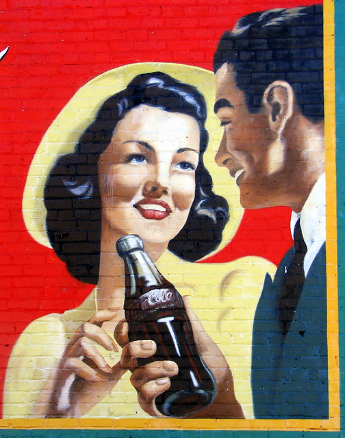 Acworth GA restored Coke Mural  C: Couple shares a Coke