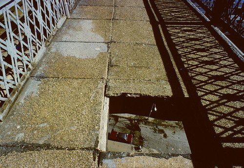 Hole in Manhattan Bridge walkway  (1980) by stevensiegel260