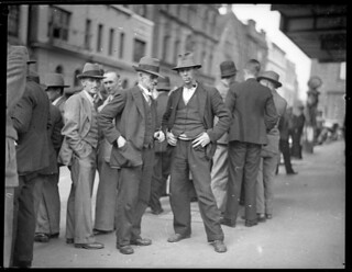 Unemployed carpenters in Phillip Street wait to hear succesful applicant for one position, 17 June 1935, by Sam Hood