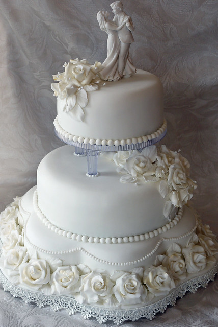 Classic Three Tier Pillared White Rose Wedding Cake
