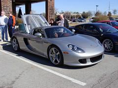 automobile(1.0), vehicle(1.0), automotive design(1.0), porsche(1.0), porsche carrera gt(1.0), land vehicle(1.0), supercar(1.0), sports car(1.0),