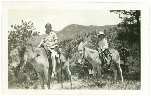 Two kids on horseback