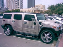 hummer h3t(0.0), automobile(1.0), automotive exterior(1.0), sport utility vehicle(1.0), vehicle(1.0), hummer h3(1.0), compact sport utility vehicle(1.0), hummer h2(1.0), bumper(1.0), land vehicle(1.0), luxury vehicle(1.0),