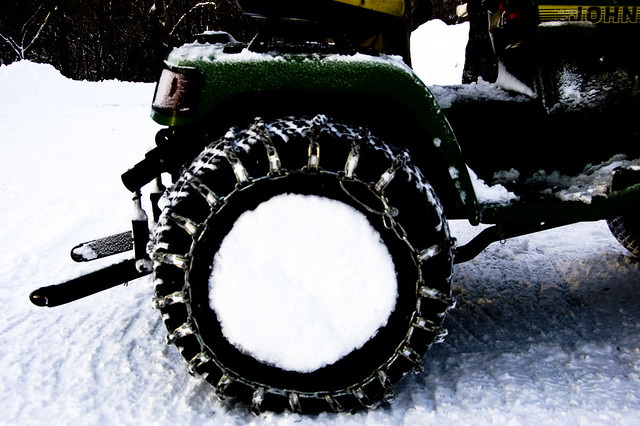 Tractor tire with chain