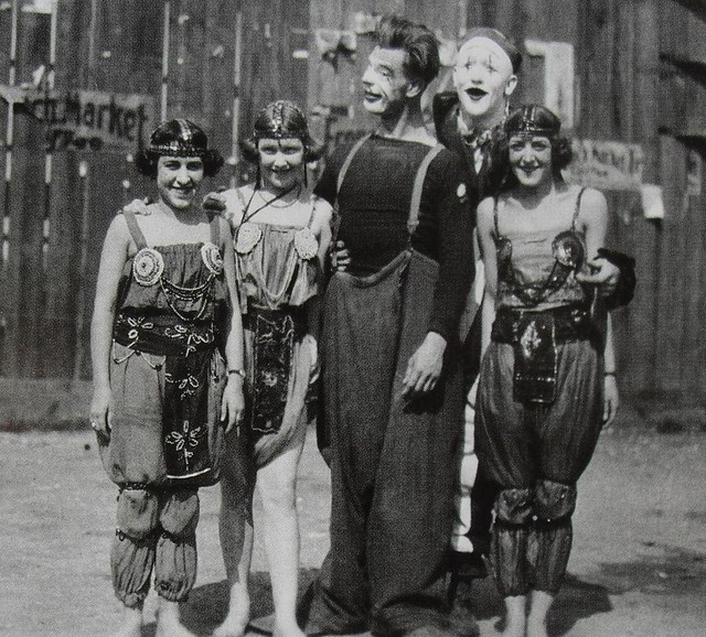 1930s men and women of circus in makeup and costume