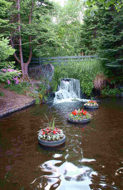 Floating flower pots with waterfall flickr photo sharing for Floating plant pots