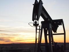 vehicle(0.0), petroleum(0.0), wind(0.0), evening(1.0), oil field(1.0), sunset(1.0),