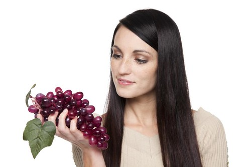 Produce - fruit woman with grapes