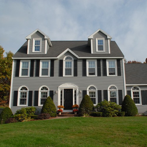 Beautiful colonial style home with newpro siding windows for Windows on homes
