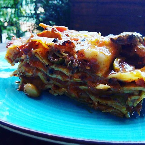 Vegan dinner - Butter Bean Pasta Al Forno - Lasagna noodle sheets dressed in layers with with tomato sauce with butter beans, green olives, peppers, garlic, red onions, capers, spices and herbs topped with homemade vegan cheese - delicious flavorful vegan