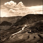 Aerial View Of Terraced Fields & Roadway With A Military Vehicle In A Mountainous Region Of The Kiangsu Province Or Yunnan Province In China [1946] Arthur Rothstein [RESTORED]
