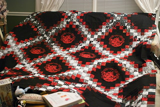 The full quilt, extended to full length.  Dragon appliqués only in the centers; I still need to decide if I want the smaller dragons on the outside spaces.