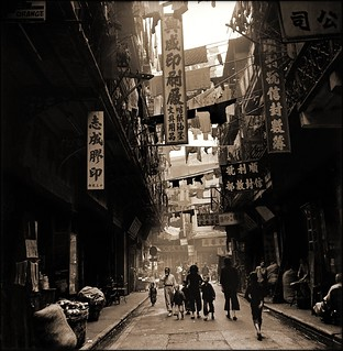 Produce & Wares From Shops Along The Sides Of A Typical Backstreet, Western District, Hong Kong Island [c1946] Hedda Morrison [RESTORED]