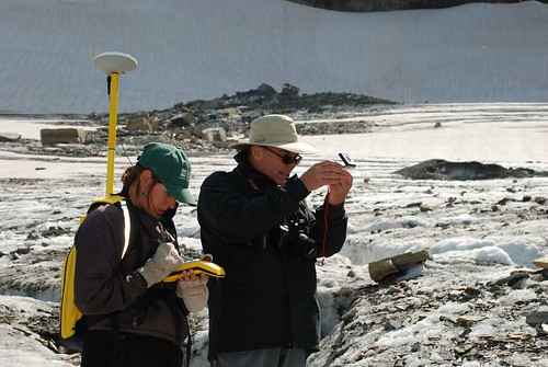 Scientists measuring the terminus of Grinnell Glacier
