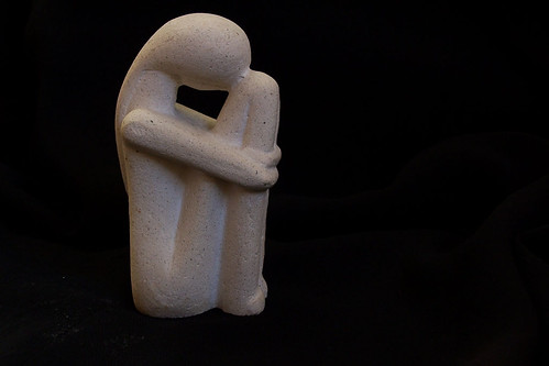 minimalistic white idol in black background