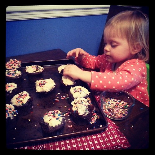 Taking her sprinkle decorating duties seriously.