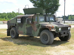 sport utility vehicle(0.0), land rover series(0.0), armored car(1.0), automobile(1.0), automotive exterior(1.0), military vehicle(1.0), vehicle(1.0), hummer h1(1.0), off-roading(1.0), humvee(1.0), off-road vehicle(1.0), bumper(1.0), land vehicle(1.0), luxury vehicle(1.0),