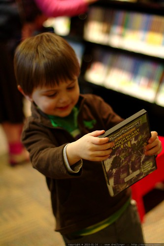 finding what he came for at the library    MG 3698