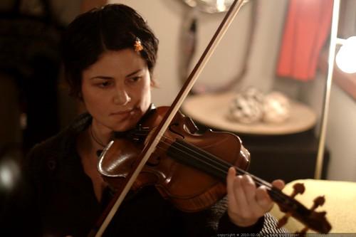 rachel, practicing violin after cleaning up borschtpocalypse